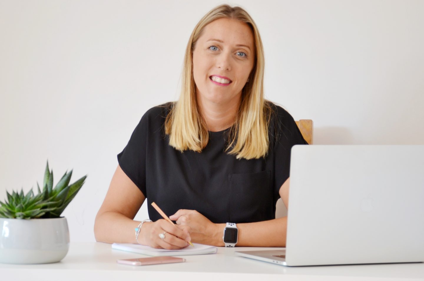 photo of Laura Moore sitting at a desk.