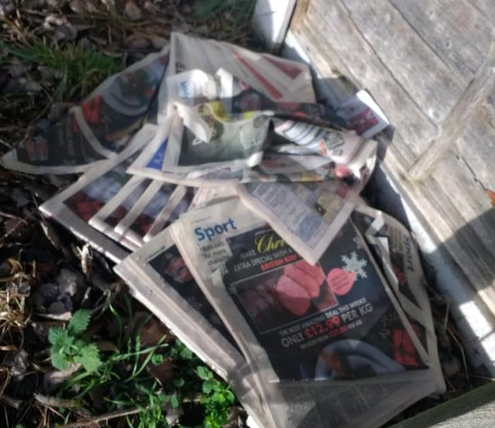 photo of a pile of discarded newspapers